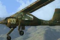 Screenshot of dark green PZL-104 Wilga in flight.