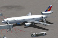 Screenshot of Philippine Airlines Douglas DC-10-30 parked at gate.