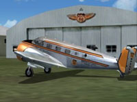 Screenshot of Phillips 66 Beechcraft D18S outside the hangar.