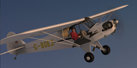Screenshot of Piper J-3 Cub G-BDEZ in the air.