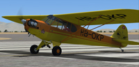 Screenshot of Piper J-3 Cub HB-OKP on runway.