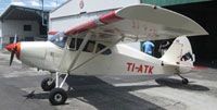 "Image showing of Piper Pacer PA22 TI-ATK ""El Torito"" on the ground."
