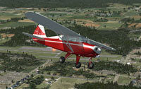 Screenshot of Piper Tri-Pacer CF-MDT in flight.
