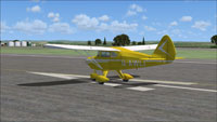 Screenshot of Piper Tri-Pacer G-AWLI on runway.