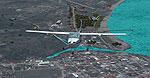 Screenshot of plane flying over the Port of Tela.