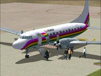 Passengers disembarking from Prinair Convair CV-580.