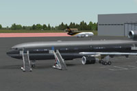 Screenshot of an all black MD-11 on the ground.