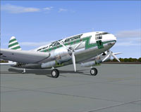 Real Nacional Curtiss C-46A idle on the ground.