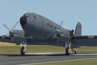 Screenshot of SAAF Basler BT-67 on runway.