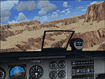 Screenshot of sandy mountains as seen from the cockpit.