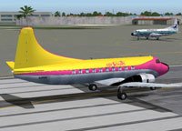The yellow and pink Shawnee Martin 404 on runway.