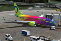 Screenshot of a brightly colored Boeing 737-700 on the ground.