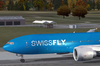Screenshot of Swissfly Virtual Airways Boeing 777-200ER on runway.