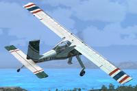 Thai Flying Club PZL-104 Wilga in the air.