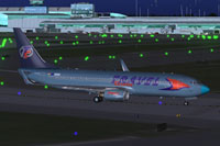Screenshot of Travel Service Boeing 737-800 on runway.