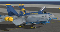 """Screenshot of """"Golden Dragons"""" US Navy FA-18E parked on carrier."""