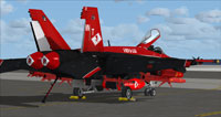 Screenshot of black and red US Navy FA-18E parked on carrier.