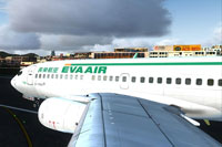 Image taken from the wing, showing the EVA Air logo on the fuselage.