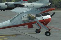 Screenshot of red and white Wilga X on the ground.