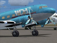 Close up of Wimbi Dira Airways Douglas C-47 on the ground.