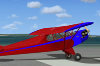 Screenshot of red and blue Piper Cub on runway.