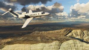 Cessna Citation CJ4 over canyon terrain.