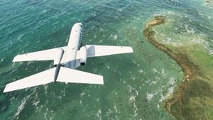 Cessna Citation CJ4 over coastline.