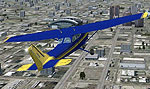 Screenshot of yellow and blue Cessna 172 in flight.