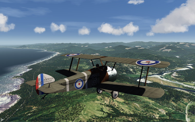 WW2 Biplane over scenery.