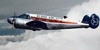 Thumbnail of Aloha Air Beech-18 in flight.