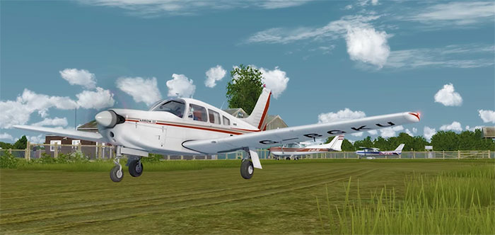 Piper Arrow III on grass.