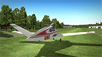 Beechcraft Bonanza on grass runway.