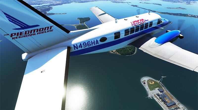 The Beech Model 99 add-on in flight over the coastline in Microsoft Flight Simulator.