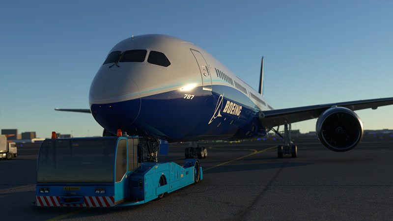 Boeing 787 with tug pushback underway.