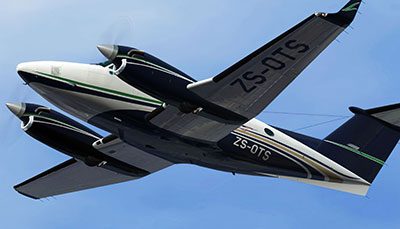 ZS-OTS Beech King Air 200 in flight in FSX after applying the repaint pack.