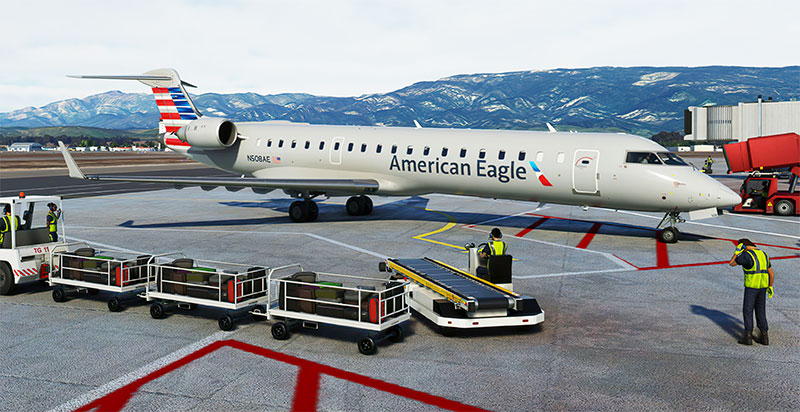 The Aerosoft CRJ550/700 on ramp with cargo being loaded in FS2020.