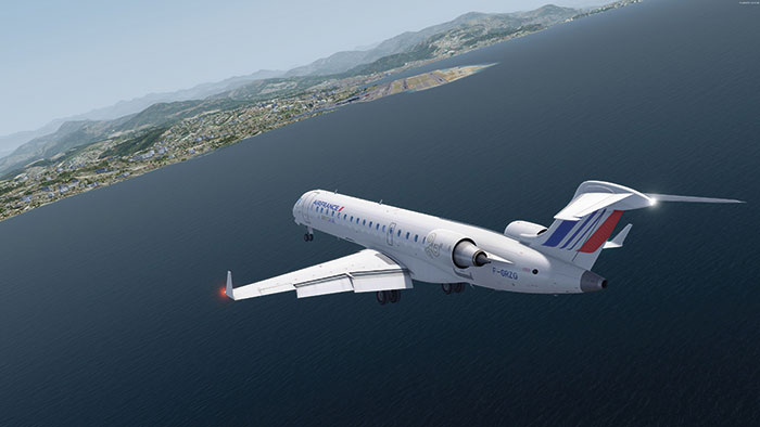 Air France CRJ flying over water on approach for landing.