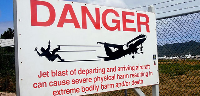 "The ""Jet Blast"" danger sign on the beach at St. Maarten"