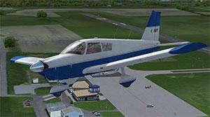 Cherokee flying over airfield