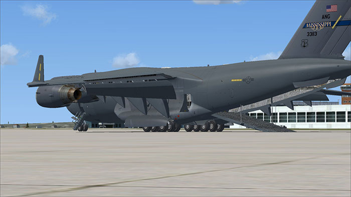 Aircraft with rear cargo doors open.
