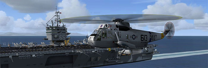 Helicopter flying past carrier