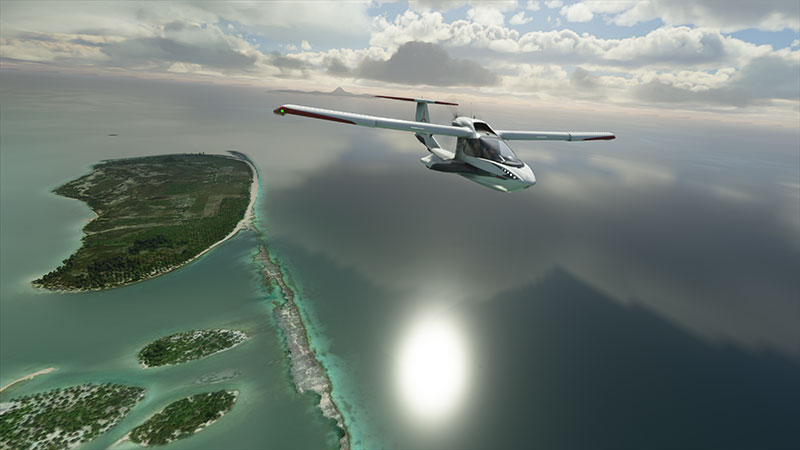 Icon A5 in flight over islands.