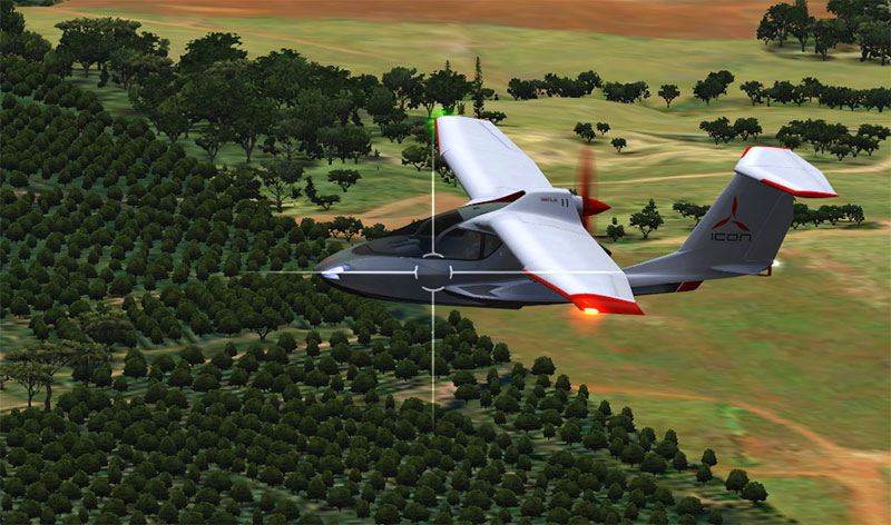 Icon A5 flying over trees.