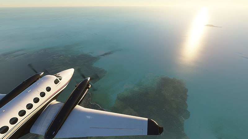 King Air 350i flying over islands.