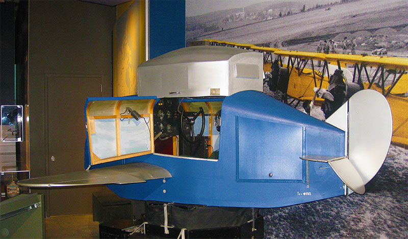 "The original ""Link Trainer"" that resides in a museum."