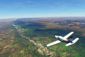 Socata TBM 930 over countryside terrain.