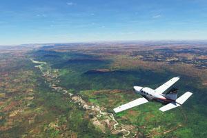 Socata TBM 930 over countryside terrain.