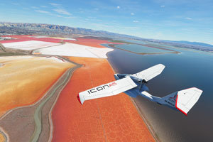 Icon A5 flying over coastline with ground terrain visible.