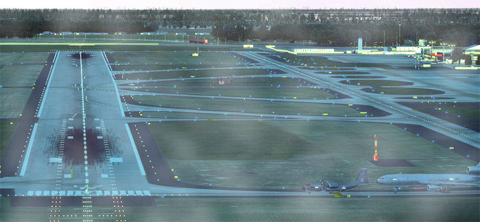 Taxiway and runway with lights on