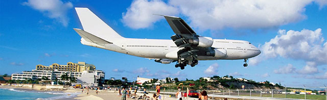 Planespotters looking at landing aircraft while relaxing on Maho beach.